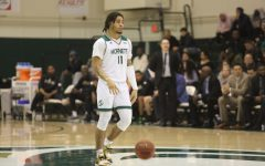 Sac State sophomore guard Brandon Davis dribbles at midcourt against Cal Poly on Wednesday, Dec. 18 at the Nest. The Hornets would lose 66-51 against Montana State University on Saturday, Dec. 28.