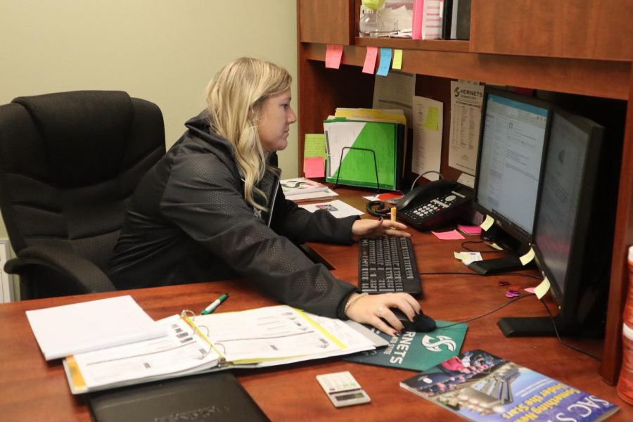 Sac State women's tennis coach Cami Hubbs works in her office at Yosemite Hall. Hubbs is entering her third year as head coach of the Hornets.