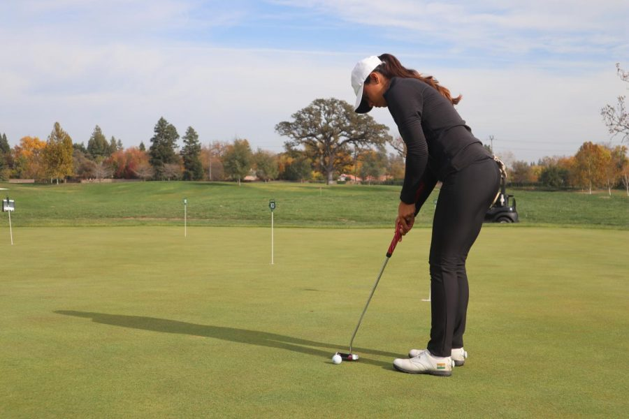 Sac+State+senior+golfer+Nishtha+Madan+practices+putting+at+Del+Paso+Country+Club+in+Sacramento%2C+California.+She%27s+intent+to+improve+her+71.9+average.