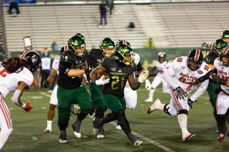 Sac State junior running back BJ Perkinson rushes for a first down against Austin Peay on Saturday, Dec. 7 at Hornet Stadium. The Hornets football team is just one of the Sac State sports