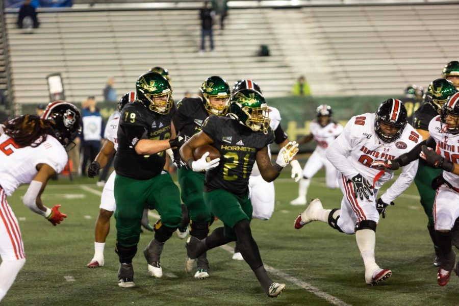 Sac State junior running back BJ Perkinson rushes for a first down against Austin Peay on Saturday, Dec. 7 at Hornet Stadium. The Hornets football team is just one of the Sac State sports' teams whose season will be postponed due to postponement of Big Sky Conference fall sports competition.