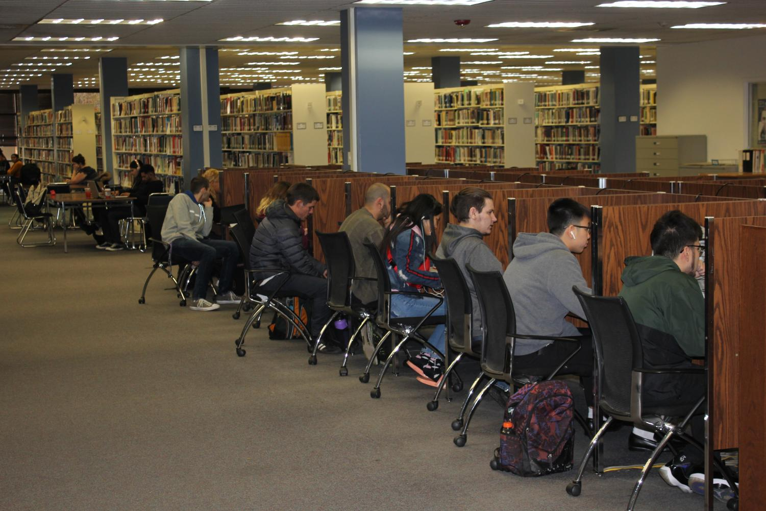 Students studying the week before finals in the Sac State Library. Next year, students may no longer have access to the updated Elsevier scientific journal database as the CSU system is renegotiating their contract with the company due to the high cost.