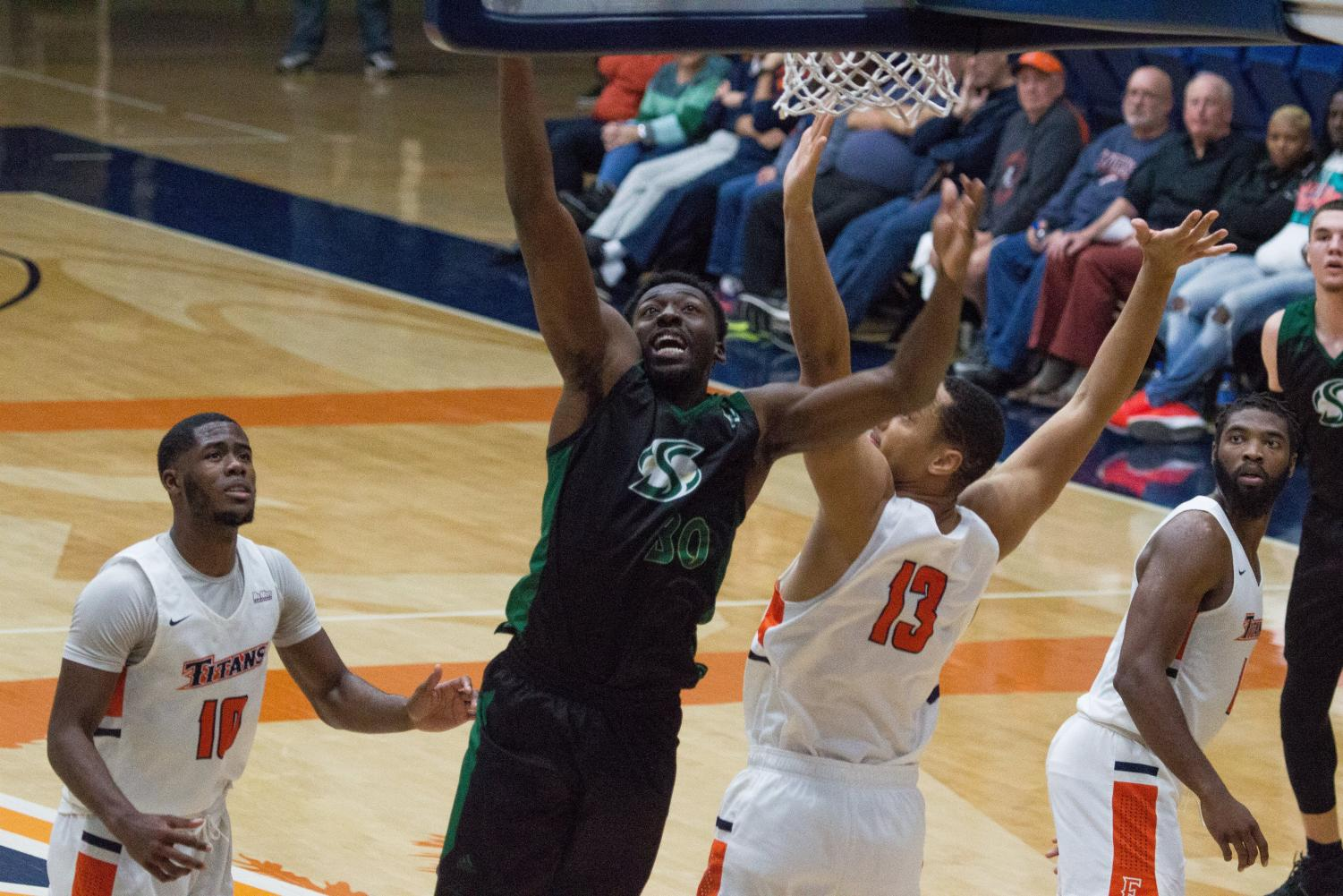 Sac State senior center Joshua Patton goes for a layup against Cal State Fullerton on Saturday, Dec. 7 at Titan Gym. The Hornets defeated the Titans 62-59 on the road to improve to 6-1 on the season.