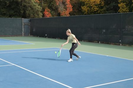 Sac State junior tennis player Jenna Dorian returns a serve during practice. The women