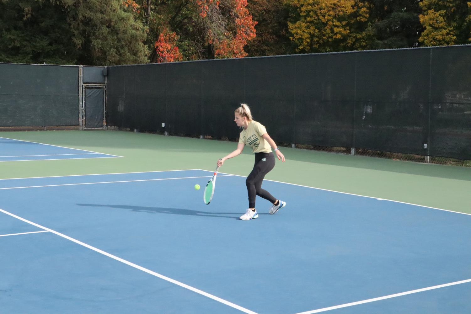 Sac State junior tennis player Jenna Dorian returns a serve during practice. The women's tennis team will be getting a new locker room in Yosemite Hall 169 for the team's 11 players.