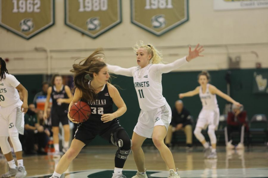 Sac State sophomore guard Summer Menke defends Montana senior guard McKenzie Johnston against the Lady Griz on Monday, Dec. 30 at the Nest. The Hornets lost to the Lady Griz 64-60.