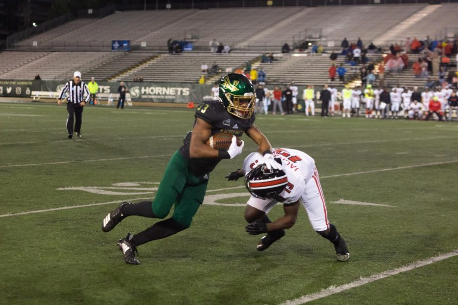 Sac+State+junior+running+back+Elijah+Dotson+stiff+arms+Austin+Peay+junior+defensive+back+Kordell+Jackson+against+the+Governors+on+Saturday%2C+Dec.+7+at+Hornet+Stadium.+Dotson+had+one+carry+for+four+yards+in+the+loss+before+leaving+with+an+injury.