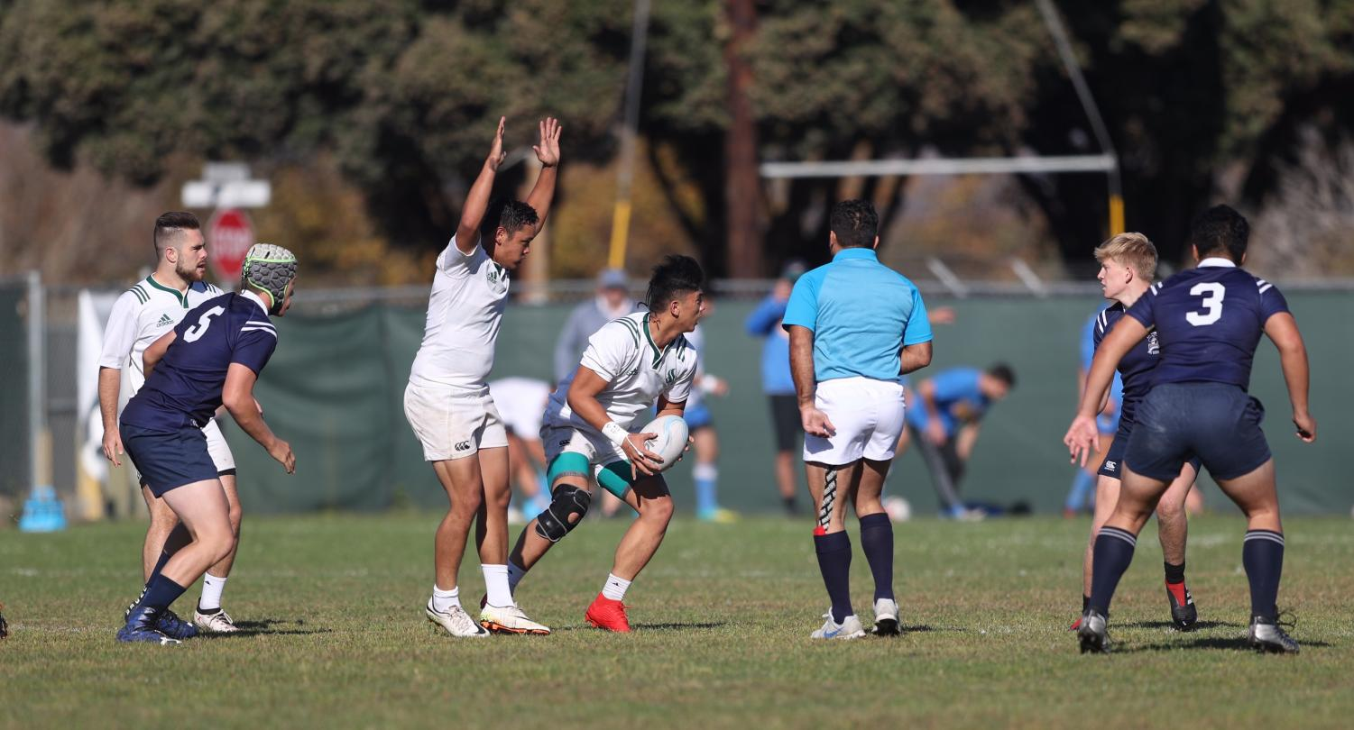 Sac State men's rugby club captain John Joshua Bocalan Reyes safely receives a pass from his teammate during a game. The rugby team qualified to compete in Nationals after their Pacific West Sevens Tournament win.