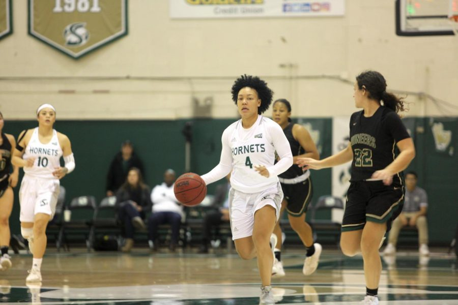Sac State senior guard Camariah King sprints past Pacific Union senior guard Elissa Root during a game against the Pioneers on Thursday, Dec. 19 at the Nest. The Hornets defeated the Pioneers 94-35.
