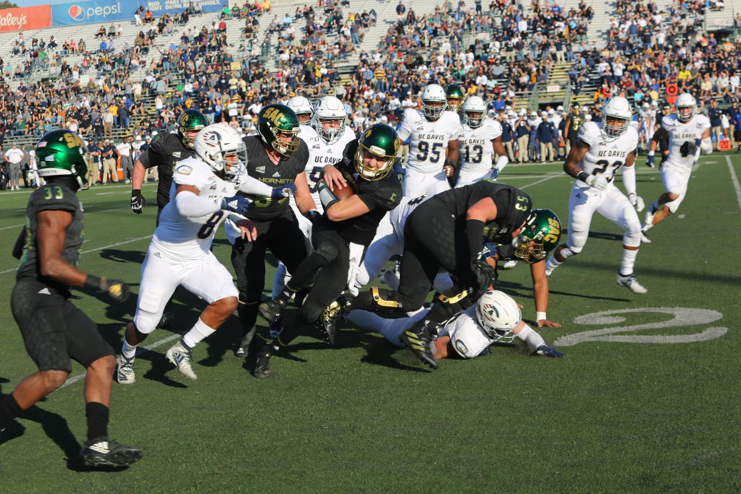 Sac State junior quarterback Kevin Thomson rushes for a first down against UC Davis on Saturday, Nov. 23 at Hornet Stadium. The No. 4 Hornets host the second round of the FCS Playoffs against Austin Peay on Saturday at 6 p.m.