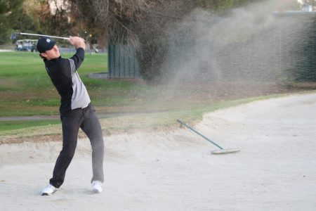 Sac State sophomore golfer Ethan Davidson works on hits out of the sand trap at Valley Hi Country Club. Davidson was named an All-Big Sky honorable mention following his freshman season.