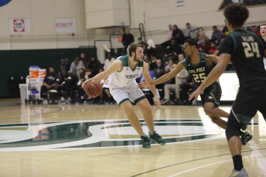 Sac State sophomore forward James Bridges dribbles in front of Cal Poly senior guard Jamal Smith on Wednesday, Dec. 18 at the Nest. The Hornets have started conference play 0-2 after a 52-50 loss to the University of Montana on Monday, Dec. 30.