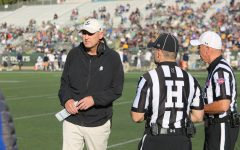 Sac State head coach Troy Taylor chats with the officials during a match against UC Davis on Saturday, Nov. 23 at Hornet Stadium. Taylor was named FCS Coach of the Year on Thursday.
