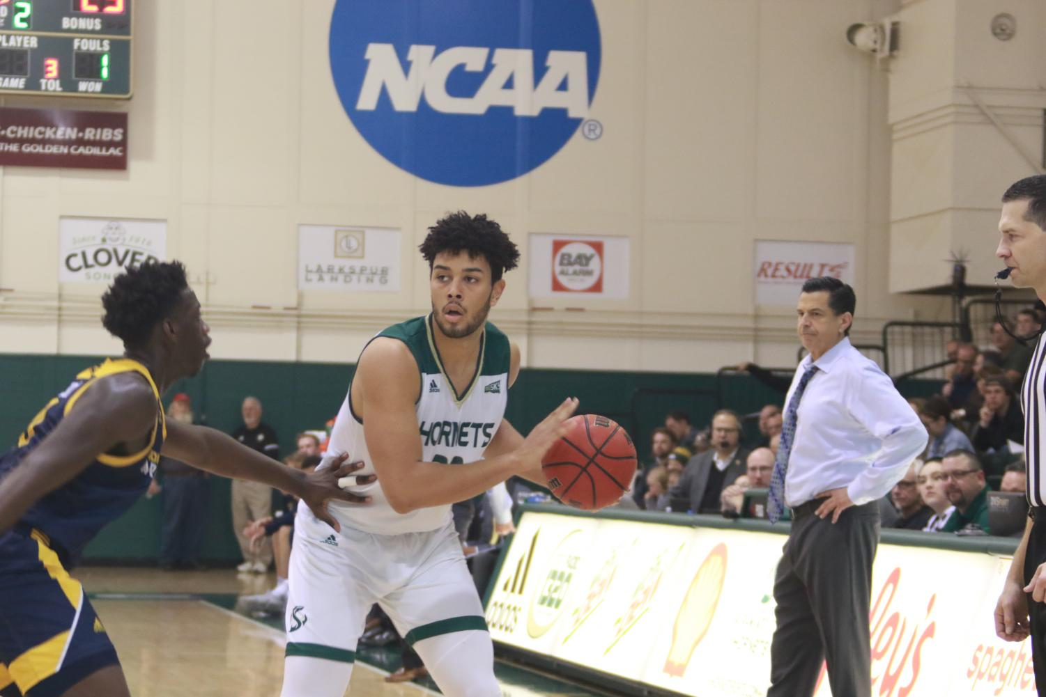 Sac State junior forward Ethan Esposito looks for a teammate to pass to against Northern Arizona on Thursday, Jan. 9 at the Nest. The Hornets defeated the Lumberjacks 64-57 on Thursday night.