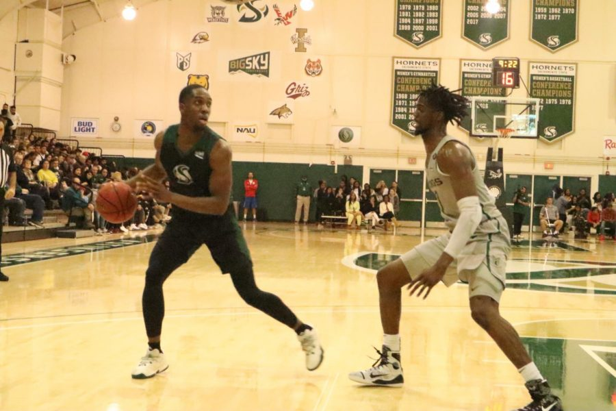 Sac State senior forward Chibueze Jacobs dribbles down the court against Portland State at the Nest on Thursday, Jan. 23. The Hornets fell to Northern Arizona 69-54 on the road Monday night.