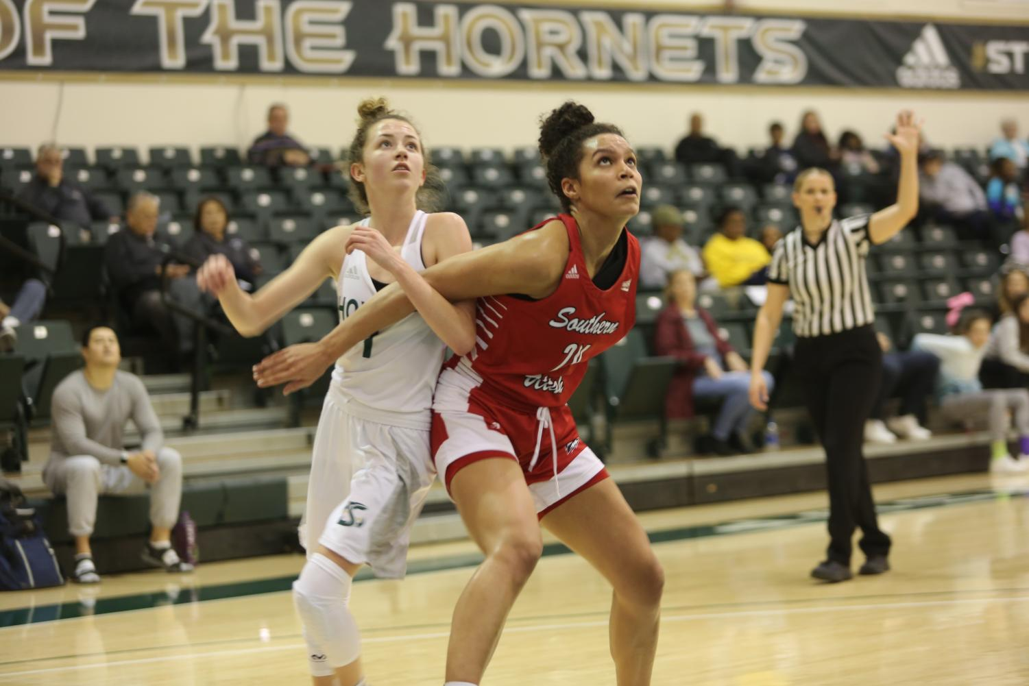 Sac State sophomore point guard Milee Enger attempts to box out Southern Utah junior forward Jessica Chatman for a rebound against the Thunderbirds on Saturday, Jan. 18 at the Nest. Enger had three rebounds, two points and two assists in the win.