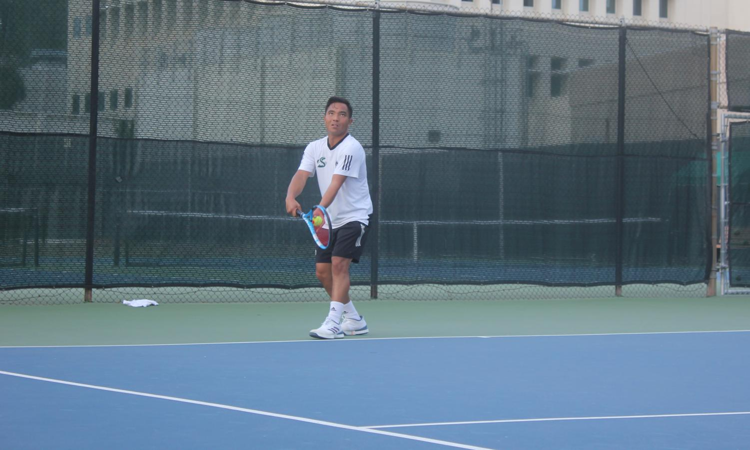 Sac State senior Hermont Legaspi prepares to serve during a singles match against Eastern Washington at the Sacramento State Courts on Friday, Jan. 24. The Hornets defeated Eastern Washington 5-2.