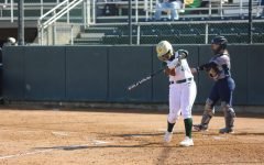 Sac State freshman third baseman Lewa Day practices her swing against California Baptist at Shea Stadium on Friday, Feb. 7. In just 14 games, Day has recorded 12 RBIs and two home runs.