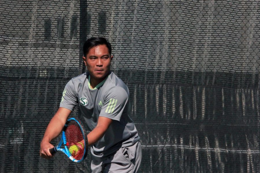 Sac State senior Hermont Legaspi prepares to serve during a doubles match against Washington at Sacramento State Courts on Saturday, Feb. 22. The Hornets lost to Washington 6-1.