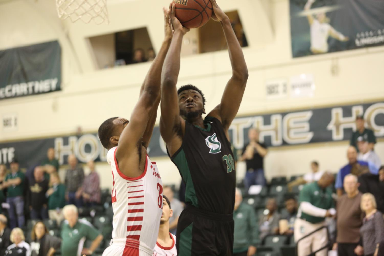 Sac State senior center Joshua Patton rises for a shot against Southern Utah at the Nest on Thursday, Feb. 13. The Hornets defeated Southern Utah 70-55.
