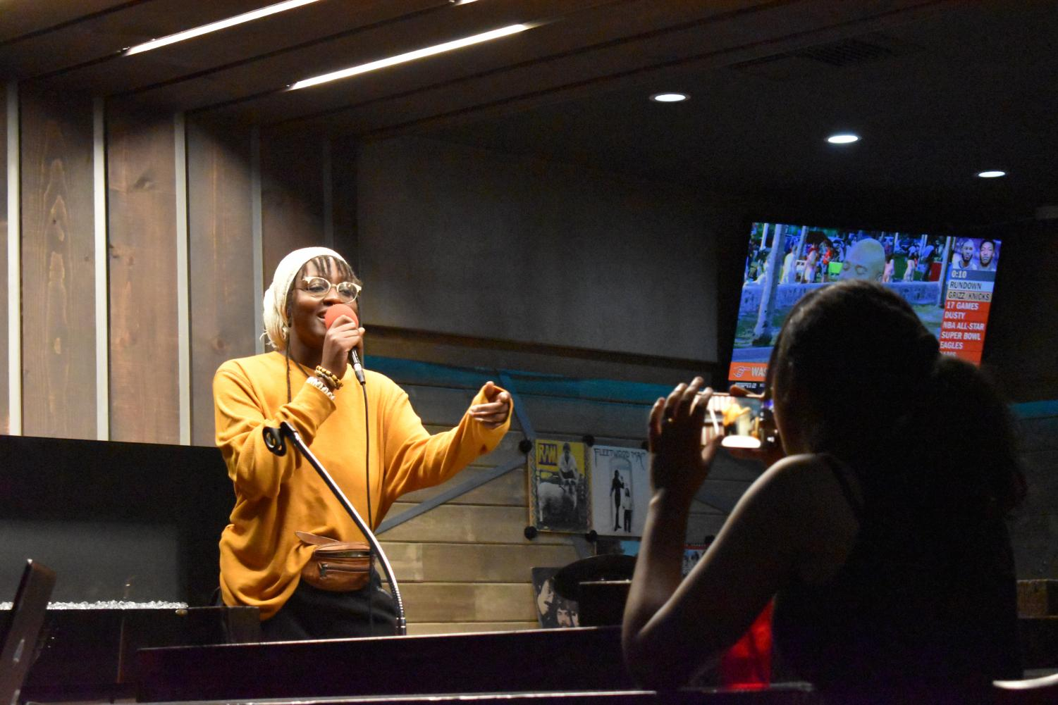Rapper and Sac State senior communications major Greo the Storyteller performs her song