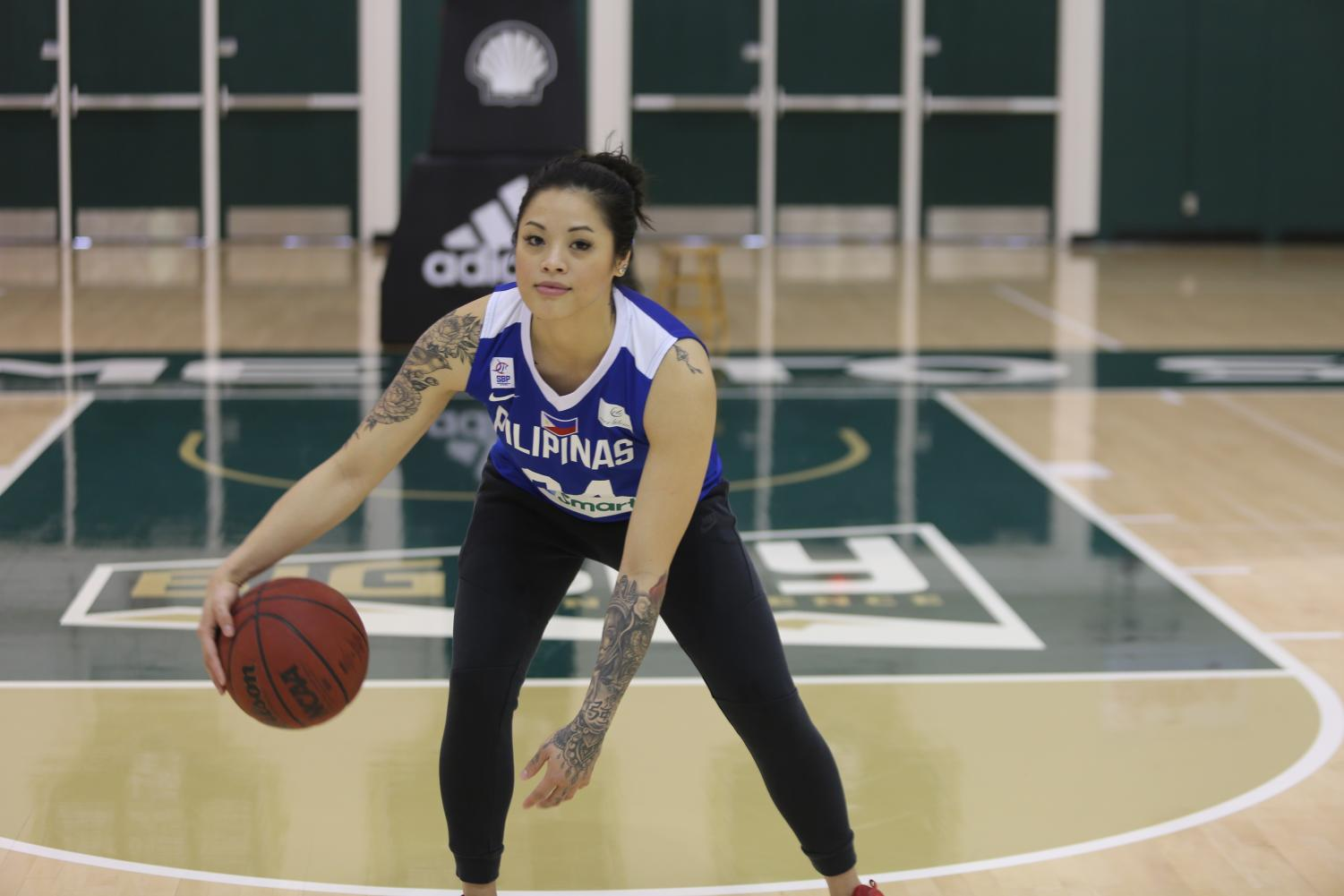 Sac State senior guard Gabi Bade crosses over while wearing her Philippines national team jersey on Monday, Jan. 26 at the Nest. Bade is one of three seniors on the Hornets' young roster.
