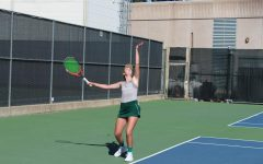 Sac State freshman Paige Alter prepares to serve in her singles match against Pacific on Sunday, Feb. 23 at the Sacramento State courts. The Hornets fell to the Tigers 6-1.