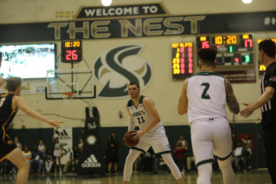 Sac State junior guard Bryce Fowler looks for a teammate in the post against Northern Colorado at the Nest on Saturday, Feb. 15.  Fowler finished with 10 points and four assists.