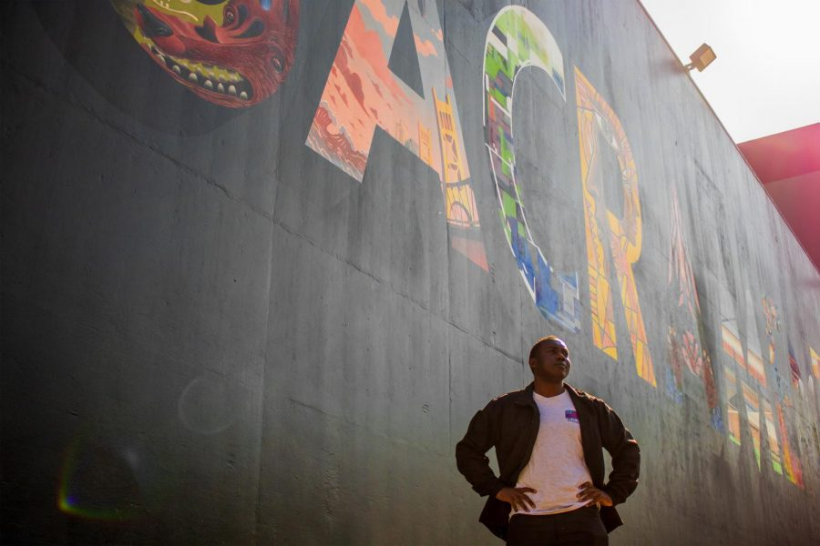 Waverly Hampton III stands in front of the Sacramento mural at Sac State on Friday, Feb. 7. Hampton is running for the Sacramento City Council District 6.