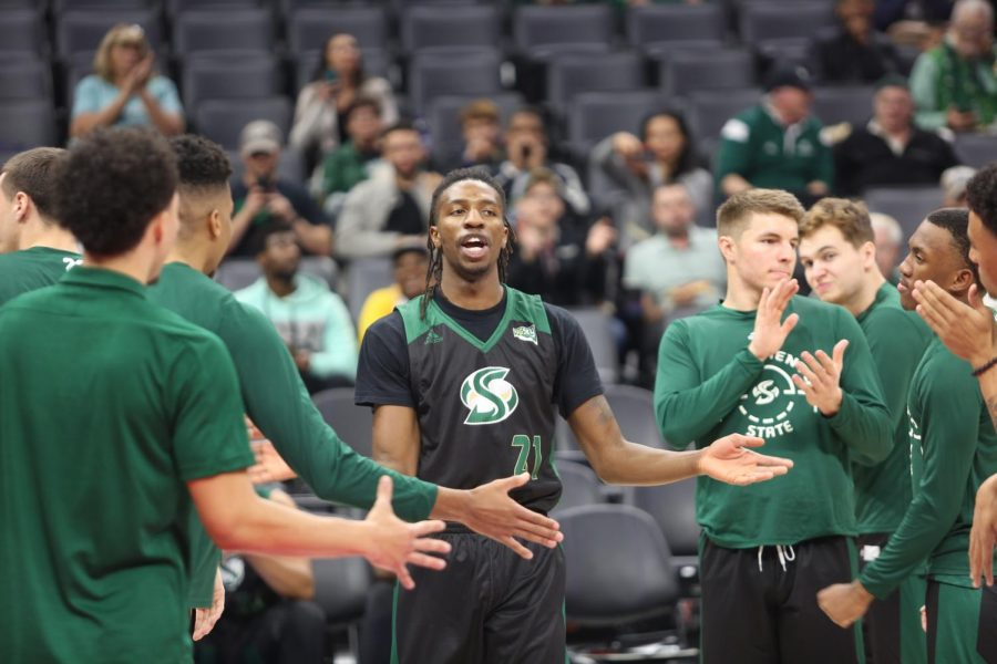 Sac State senior forward Osi Nwachukwu high-fives teammates during pregame introductions before playing UC Davis on Wednesday, Nov. 20, 2019 at the Golden 1 Center.