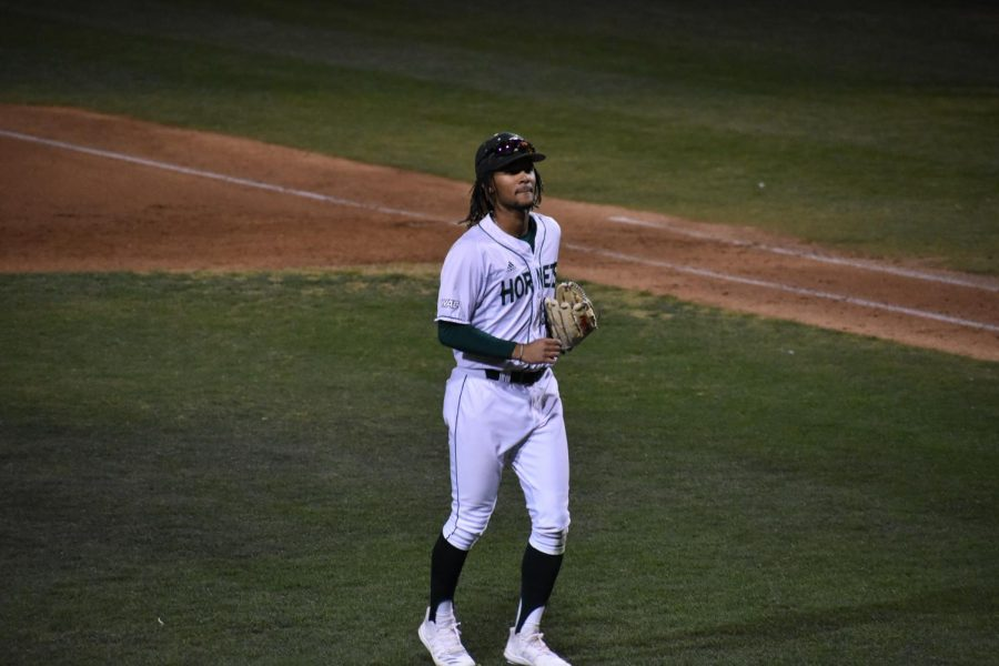 Sac State freshman outfielder Isaiah Parker walks off the field after win against University of Wisconsin Milwaukee on Friday, Feb. 21 at John Smith Field. Parker plays multiple positions for the Hornets.