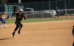 Sac State junior outfielder Charizma Guzman runs to third base against UC Santa Barbara at Shea Stadium on Sunday, Feb. 9. The Hornets took home three victories during the LMU tournament over the weekend.