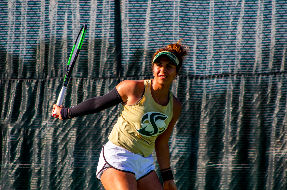 Sac State's Ege Tomey looks to see whether her returned ball makes it in or out during a singles game home match on Saturday, Feb. 1. The Hornets fell to the University of San Francisco 6-1.