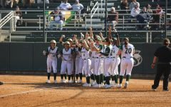 The Sac State softball team celebrate senior catcher Jessica Scott's home run against California Baptist at Shea Stadium on Friday, Feb. 7. The Hornets defeated California Baptist 6-0.