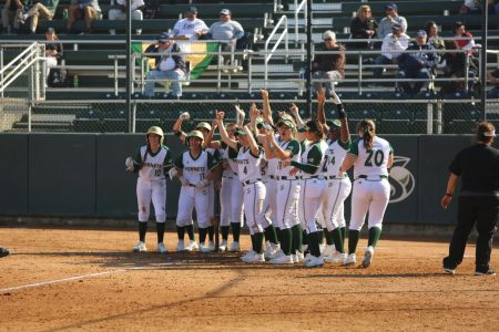 The Sac State softball team celebrate senior catcher Jessica Scott