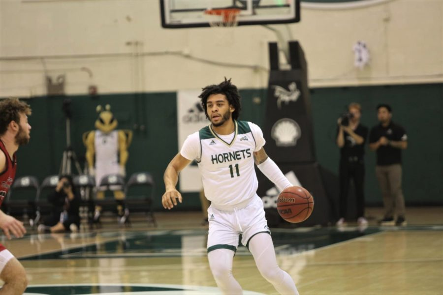 Sac+State+sophomore+guard+Brandon+Davis+drives+down+the+court+against+Eastern+Washington+at+the+Nest+on+Saturday%2C+Feb.+1.+Davis+averages+close+to+seven+points+per+game.