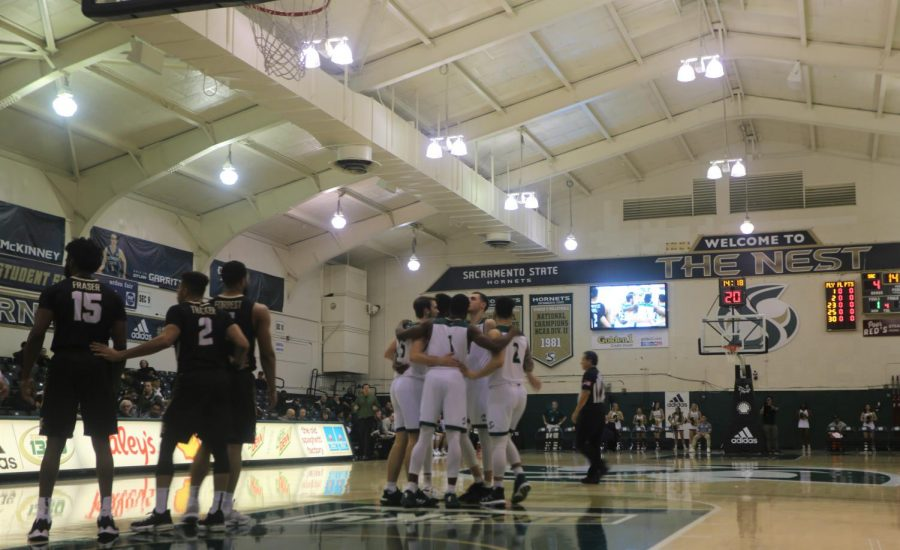 The Sac State men's basketball team huddles during the game against Idaho on Monday, Feb. 4 at the Nest. The Hornets fell 67-53 to the Vandals.