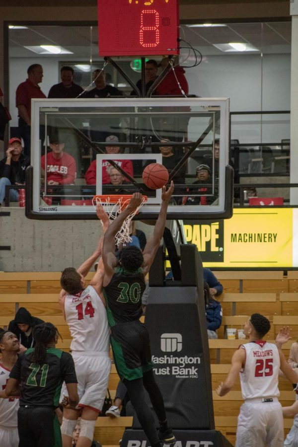 Sac State senior center Joshua Patton goes up for the slam against Eastern Washington on Thursday, Feb. 20 at Reese Court. The Hornets fell to the Eagles 77-76.