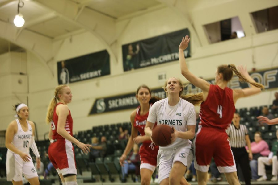 Sac State sophomore forward Tiana Johnson drives to the basket past Southern Utah senior forward Ashley Larsen against the Thunderbirds on Saturday, Jan. 18 at the Nest. The Hornets defeated Southern Utah 71-62 on the road Thursday.