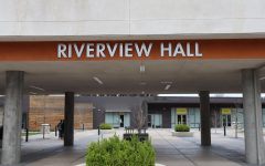 The early move-outs prompted by the coronavirus leave the Riverview Hall plaza empty aside from two people pushing a wheeled moving cart on March 18, 2020. Dorm residents will be consolidated into American River Courtyard and Riverview Hall, according to an email from University Housing Services.