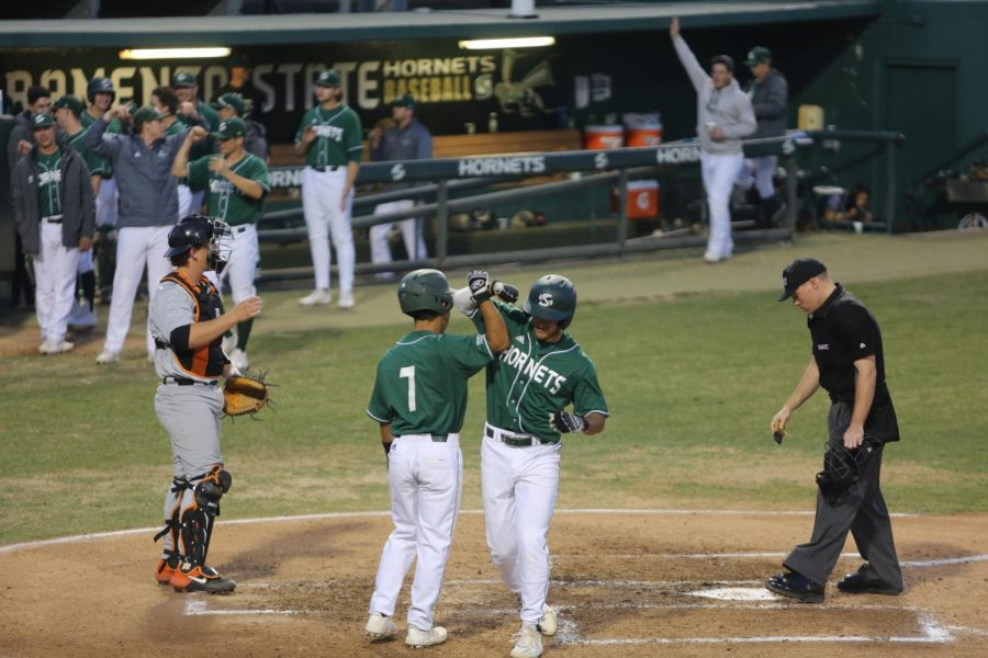Sac State freshman second baseman Jorge Bojorquez celebrates his home run with junior shortstop Keith Torres against Pacific on Tuesday, March 3 at John Smith Field. The Hornets defeated the Tigers 9-2.