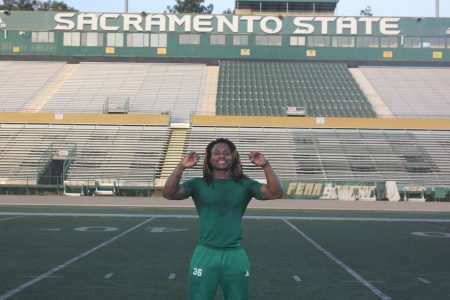 Sac State defensive back Prince Washington poses for a photo in Hornet Stadium after the team
