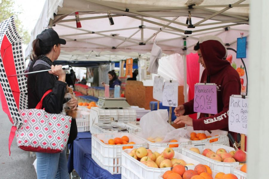 Sacramento locals shop for fresh produce at the Midtown Farmers Market Saturday, March 14. The market remained open despite concerns about the spread of the coronavirus.