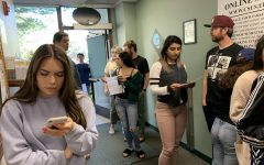 Students wait in line at the Sac State UTAPS office on Thursday, March 12. UTAPS extended the last date to get a 50% refund on spring parking permits to March 20 after initially stating it was March 13.