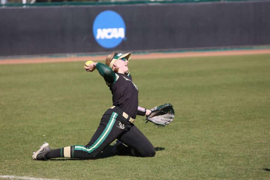 Sac State freshman outfielder Haley Hanson throws a ball from her knees against UC Santa Barbara at Shea Stadium on Sunday, Feb. 9. The Hornets came home with only one win during the Wolf Pack Classic over the weekend.