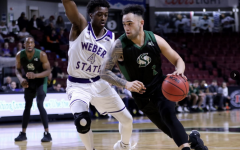 Sac State senior guard Izayah Mauriohooho-Le'afa dribbles the ball down court against Weber State on Wednesday, March 11 at CenturyLink Arena. Sac State spring sports teams' seasons have been suspended indefinitely due to the outbreak of the coronavirus.