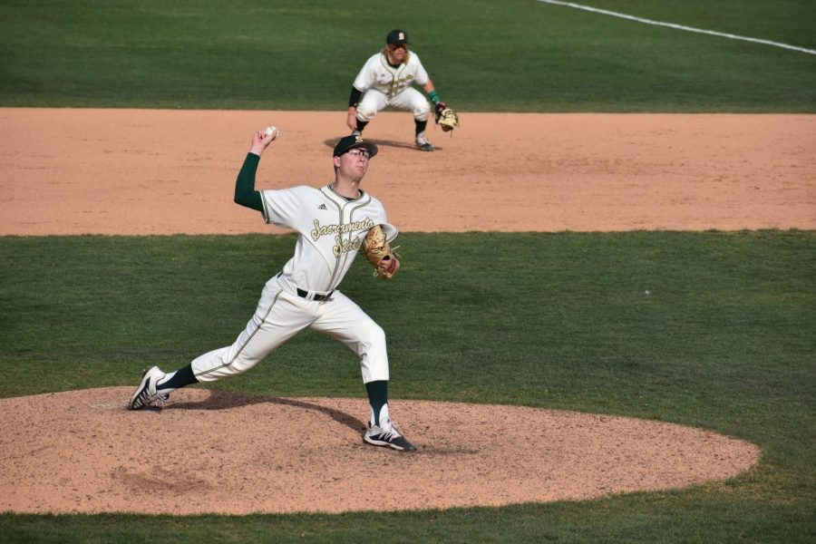 Sac State junior pitcher Stone Churby throws a pitch against Santa Clara on Sunday, March 1 at John Smith Field. The Athletics Department announced Wednesday it would be implementing new policies to limit attendance at all future home athletic events.