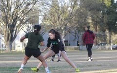 Women's rugby club president Sarah Armanino attempts to stop her teammate in a practice drill Tuesday, Feb. 25. The women's rugby club prides itself on being open to all skill levels.