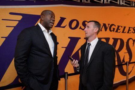 "Sac State alumnus Sam Amick interviews Basketball Hall of Famer Earvin ""Magic"" Johnson before a Clippers and Lakers game on Oct. 19, 2017 at the Staples Center. Amick currently works as an NBA insider for The Athletic, and was one of the few reporters assigned to work inside the NBA bubble."