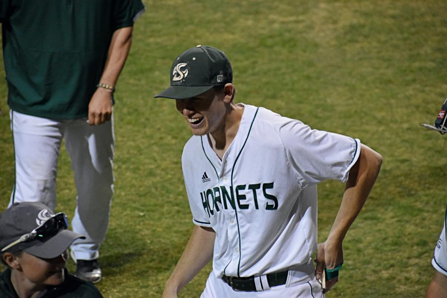 Sac State senior pitcher Parker Brahms walks to the dugout at John Smith Field smiling, following a 4-0 win against the University of Wisconsin, Milwaukee on Friday, Feb. 21. Brahms was excited as he cemented himself in Sac State history as the all-time leader in strikeouts.